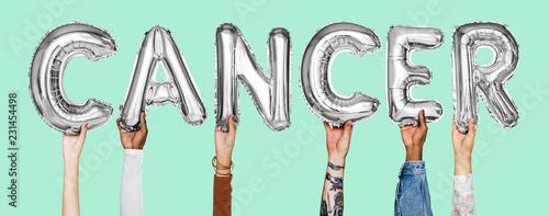 Leinwanddruck Bild Hands showing cancer balloons word
