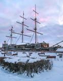 Winter St. Petersburg. Ships in the ice on the Neva River. Winter sunrise. - 231462822