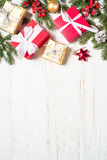 Red and Gold present box and decorations on white wooden backgro - 231470624