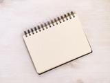 Spiral notebook with dotted pattern on white wooden table. Top view. - 231470696