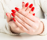 young woman with red manicure on nails - 231479296