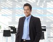 Happy asian businessman at office lobby