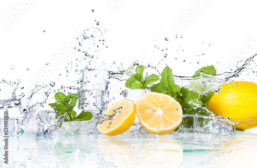 ice cubes and splashing water with mint and lemon on a white background... © jaroslavkettner