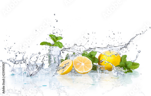 ice cubes and splashing water with mint and lemon on a white background © jaroslavkettner