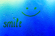 "Leinwanddruck Bild - The inscription on the sweaty glass. The word ""smile"" written on glass"