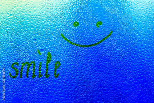 "Leinwanddruck Bild The inscription on the sweaty glass. The word ""smile"" written on glass"