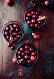Mulled Wine for Christmas. Hot red wine with cranberries and spices.  Flat lay. Homemade natural drink - 231510464
