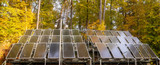 solar panels surrounded by an autumn forest-Panorama - 231514637