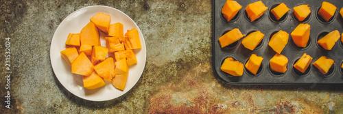 orange pumpkin (pieces of fresh pumpkin). Vegan food. Flat lay. Diet menu. Top view