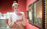 Woman visitor using  phone  in the historical museum - 231541632