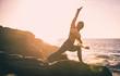Leinwanddruck Bild - Woman making yoga poses in Baker beach, San francisco