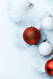 Red and white Christmas balls with white feathers. From above. Copy space - 231543070