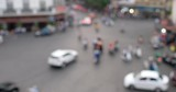 Defocus or out of focus traffic. Day traffic blurry in downtown Hanoi city with lots of motorcycles, motorbike, bus, car, and people walking transport on the road. Aerial view city in rush hour - 231544893