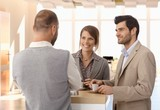 Business people talking at coffee table at office - 231547691