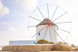 Windmill on a hill near the sea on the island of Mykonos in Greece - 231551445