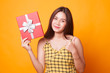 Young Asian woman thumbs up with a gift box.
