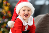 Kid wearing santa costume looking at you