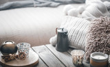 still life from home interior on a wooden background with a candle - 231560856