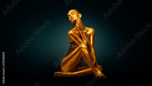 Leinwandbild Motiv High Fashion model girl with bright golden sparkles on her body posing, full length portrait of beautiful sexy woman with glowing body skin. Art design makeup