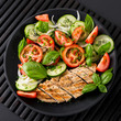 Vegetable salad and grilled chicken on a black background. Healthy food. Diet. - 231572030