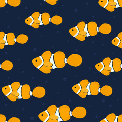 Seamless pattern with aquarium fish. There are orange clown fishes in the picture. Vector illustration on a dark blue background. © irynaalex