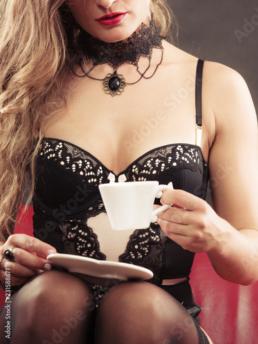 Woman wearing sexy lingerie having coffee cup - 231588671
