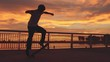 Silhouette of Skateboarder doing extreme flip trick at sunset with lens flare