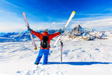 Man skiing on fresh powder snow with Matterhorn in background, Zermatt in Swiss Alps. - 231626679
