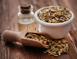 Fennel seeds with essential oil in a bottle - 231626806