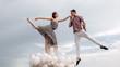 Leinwanddruck Bild - High flying romance. Ballet couple into love relations. Romantic relations between ballerina and ballet partner. Couple in love. Ballet dancers falling in love. Reaching the sky