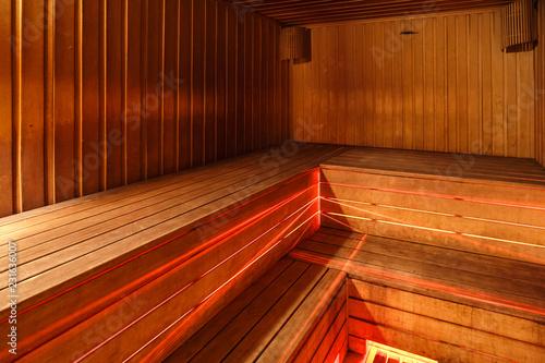 Leinwanddruck Bild Large standard design classic wooden russian bath sauna interior with hot stones
