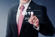 Businessman select 2019 number on digital screen