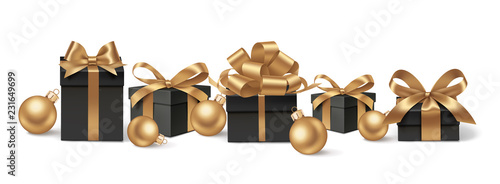 Set of decorative black gift boxes with golden bows and gold Christmas balls isolated on white for New Year Sale design. Vector illustration © Gizele