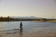 Leinwanddruck Bild - Fisherman flyfishing in river of Idaho state