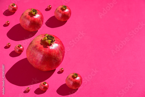 Foto Murales Pomegranates on red background