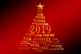 2019 new year multilingual text word cloud greeting card in the shape of a christmas tree - 231657414