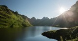 Time lapse of the sun moving over the Ågvatnet lake on the Lofoten archipelago in Norway. - 231671277