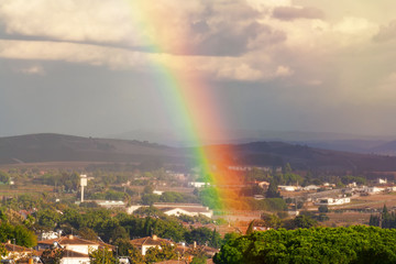 Very beautiful rainbow over the city after the rain.