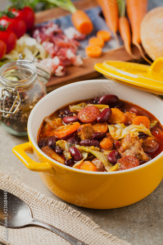 Foto Murales Traditional portuguese goulash with cabbage, beans and ribs.