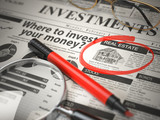 Real Estate is a best option to invest. Where to Invest concept, Investmets newspaper with loupe and marker. - 231691444