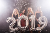 Party, people and new year holidays concept - cheerful young women celebrating new years eve 2019 - 231694828