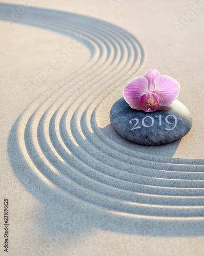 Leinwanddruck Bild Orchidee auf Stein im Sand 2019
