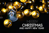 Merry Christmas and Happy New Year Christmas Decoration White House inside Glass Between Lights Bulb - 231697866