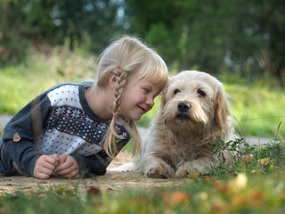 Emotional portrait of a dog and a child