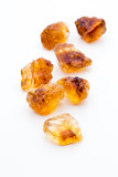 Brown caramelized sugar on white background. - 231700871
