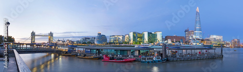 LONDON, GREAT BRITAIN - SEPTEMBER 15, 2017:  The panorama with the Tower bridge Town hall, Shard and riverside in the morning light. - 231701067