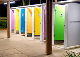 Colorful WC cabins at night in a city square - 231701845
