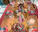 Table served for Christmas dinner in living room, red color dominant - 231702217