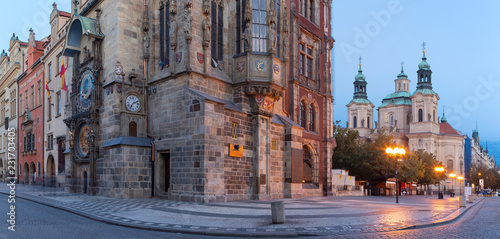 Prague - The Old Town hall, Orloj, Staromestske square and St. Nicholas church at dusk.