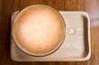 coffee latte on wood plate